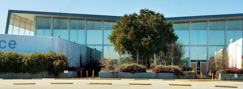 JET FIRM BRINGING OPERATIONS TO HISTORIC BRANIFF BUILDINGS AT DALLAS' LOVE FIELD